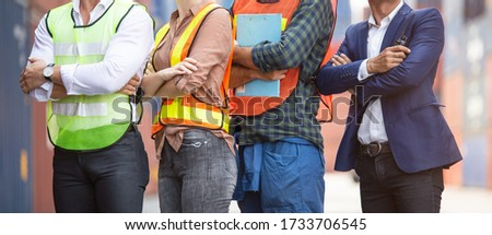 Banner of factory construction site or container warehouse people standing with arms crossed. Logistic business corporate teamwork successful. engineer foreman, assistant and workers working together Royalty-Free Stock Photo #1733706545