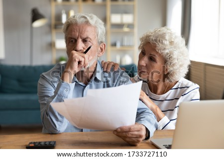 Compassionate elderly woman supporting upset stressed mature husband, received bad news banking letter. Unhappy depressed family married couple having financial trouble, got house eviction notice. #1733727110