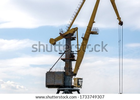 Fragment of an old gantry crane: platform, cab, counterweight, shooting device. Copy space. #1733749307
