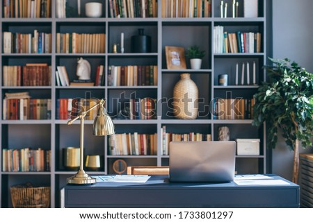 Table with laptop in home office interior. Royalty-Free Stock Photo #1733801297