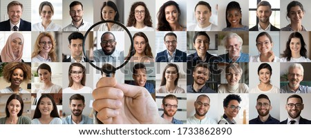 Male employer holding magnifier in hand finding unique talent african ethnic job candidate choosing among many lot of multiethnic people different faces collage. Recruiting, human resources concept. Royalty-Free Stock Photo #1733862890