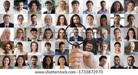 Male hr manager holding magnifier choosing hunting human resources data finding new right recruit among multiethnic professional people faces collage. Recruitment assessment, staff search concept. #1733872970