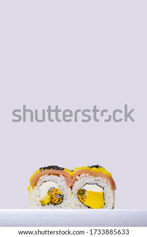 sushi rolls with avocado Japanese cuisine home made food photography on white background poster concept vertical format of picture with empty copy space for your text here