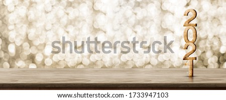 2021 happy new year wood number (3d rendering) on wood table with sparkling gold bokeh wall,leave space for display of product for promotion on christmas and new year holiday #1733947103