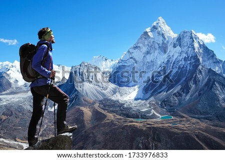 Hiking in mountains. Traveler with backpack on a top of a mounta #1733976833