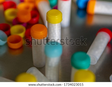 Colorful plastic Bottles filled with white homeopathic pills/globules #1734023015