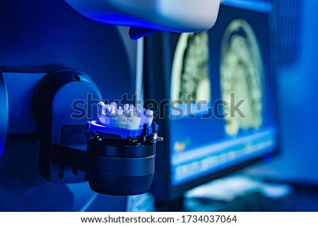Dentistry. Workplace dental technician. Production of dental crowns. Milling dental system with computer control. Grinding and milling machine of dentures. Laboratory milling cutter for dental work. #1734037064