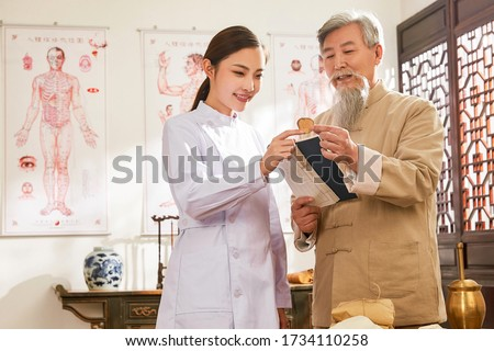Old to young doctor of traditional Chinese medicine Chinese native medicine ingredient Royalty-Free Stock Photo #1734110258