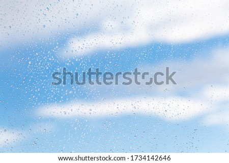 raindrops on glass sky texture. Pure blue fresh clean. Window view background screensaver. Place for text banner. Drops after rain wet sunny day wallpaper silence calm summer freshen up