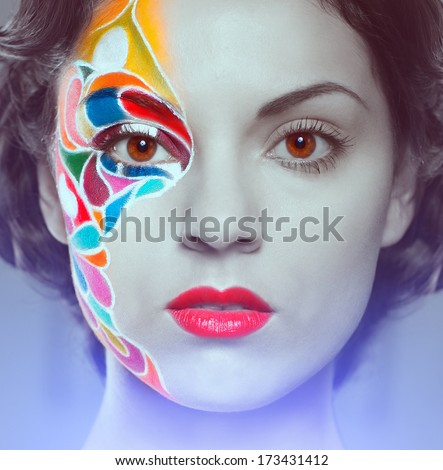 Portrait of a beautiful young model with bright make up #173431412