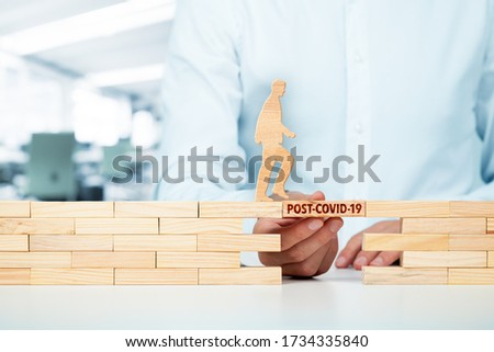 Post-covid-19 era concept. New phase and opportunity for humankind and individual persons after end of covid-19 pandemic. Helping hand of crisis manager. Royalty-Free Stock Photo #1734335840