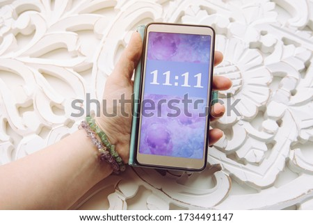 Person looking and seeing similar numbers. Seeing same similar numbers is called Angel numbers. Angels sending cryptic messages and communicating concept. #1734491147