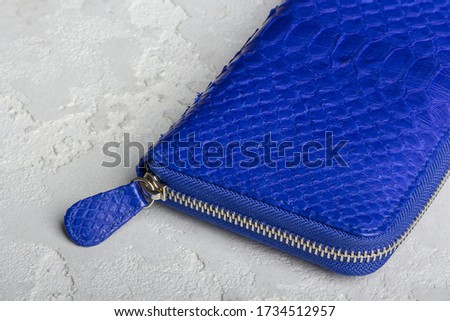 Blue leather wallet  on grey background #1734512957