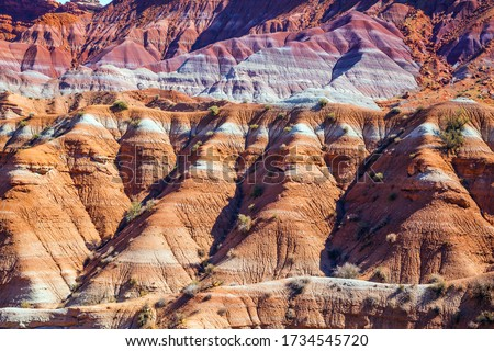 Arizona and Utah, USA. Huge slopes of red sandstone, striped from various inclusions of rocks. Paria Canyon-Vermilion Cliffs Wilderness Area. The concept of active, extreme and photo tourism #1734545720