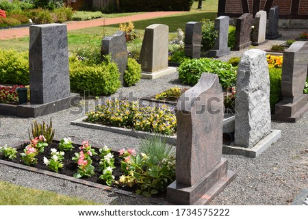 Graves in a well-kept village cemetery Royalty-Free Stock Photo #1734575222
