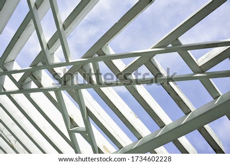 A canopy from polycarbonate arc. Metalware on the blue sky #1734602228