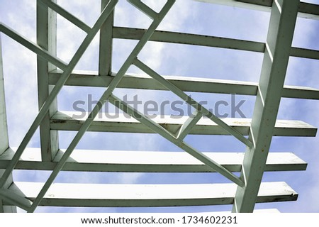 A canopy from polycarbonate arc. Metalware on the blue sky #1734602231