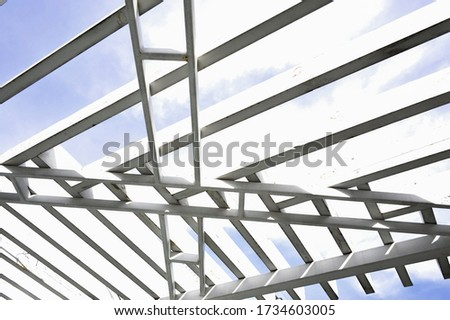 A canopy from polycarbonate arc. Metalware on the blue sky #1734603005