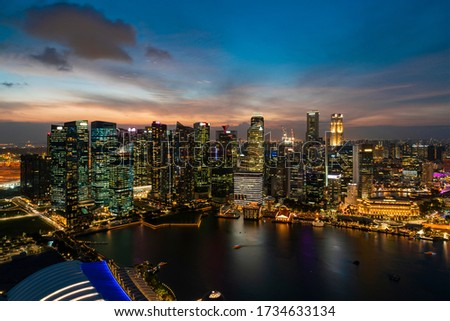 Picturesque panoramic view of Singapore city at sunset. Financial and trading center hub in Asia region. Concept of success. Modern buildings in high-tech world. Royalty-Free Stock Photo #1734633134