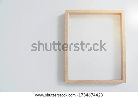 Image of a wood frame with blank spaces.
