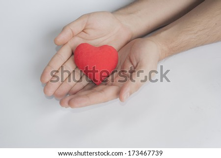 red heart on palm as a concept of giving love #173467739