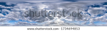 Seamless hdri panorama 360 degrees angle view blue overcast sky with beautiful fluffy cumulus clouds without ground for use in 3d graphics or game development as sky dome or edit drone shot Royalty-Free Stock Photo #1734694853