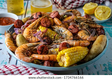 Traditional Southern U.S. Low Country boil. A Summertime feast. Royalty-Free Stock Photo #1734766166