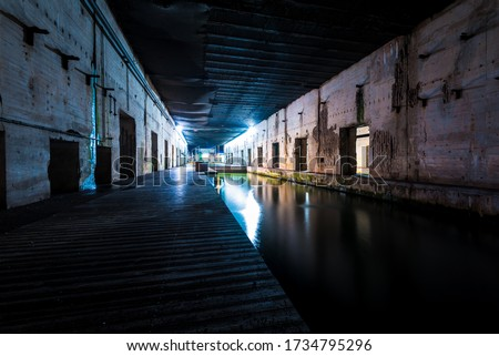 Illuminated submarine base of Saint-Nazaire at night, France. Travel destinations, sightseeing, history, World War II theme