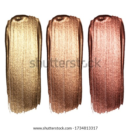 Creative brushstrokes of gold paint isolated on a white background. Gold paint texture.Acrylic gold paint. Smears of cosmetics, blush, highlighter, eye shadow, lipstick. #1734813317
