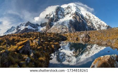 Evening view of mount Salkantay mirroring in lake, Salkantay trek in the way to Machu Picchu, Cuzco area in Peru #1734818261