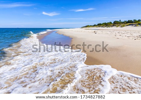 Beautiful sandy beach on Hel Peninsula, Baltic sea, Pomeranian Voivodeship, Poland. Hel is a 35-km-long sand bar peninsula in northern Poland separating the Bay of Puck from the open Baltic Sea Royalty-Free Stock Photo #1734827882
