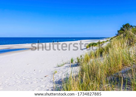 Beautiful sandy beach on Hel Peninsula, Baltic sea, Pomeranian Voivodeship, Poland. Hel is a 35-km-long sand bar peninsula in northern Poland separating the Bay of Puck from the open Baltic Sea Royalty-Free Stock Photo #1734827885