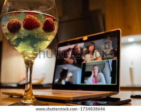 Having a cocktail with friends during a video call during the pandemic #1734838646