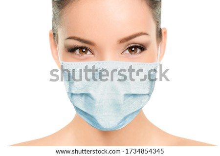 Beautiful Asian woman wearing medical face mask with eyes makeup beauty model portrait isolated on white background for Coronavirus. #1734854345