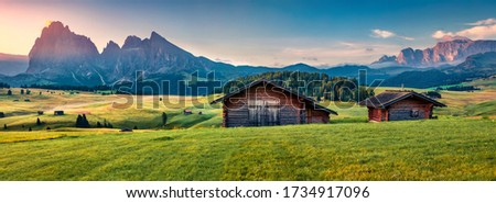 Panoramic morning view of Compaccio village, Seiser Alm or Alpe di Siusi location, Bolzano province, South Tyrol, Italy, Europe. Beautiful summer sunrise of Dolomiti Alps. Traveling concept background Royalty-Free Stock Photo #1734917096