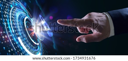 Cyber security data protection business technology privacy concept. Young businessman  select the icon security on the virtual display. Royalty-Free Stock Photo #1734931676