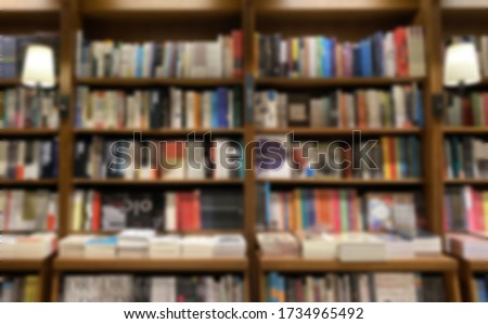 Blur image of bookshelf and retro lamp. Empty bookstore or college or library concept photo.