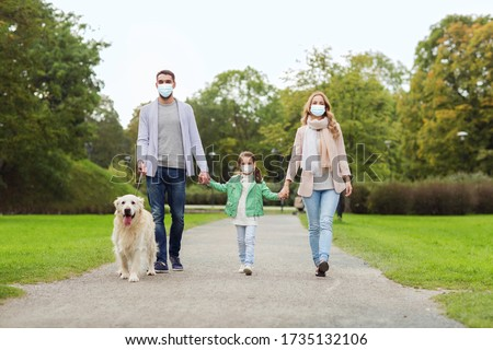family, pandemic and health concept - mother, father and little daughter wearing face protective medical mask for protection from virus disease with labrador retriever dog walking in summer park #1735132106