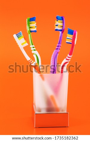 a set of wonderful comfortable and beautiful toothbrushes in a glass frosted glass #1735182362