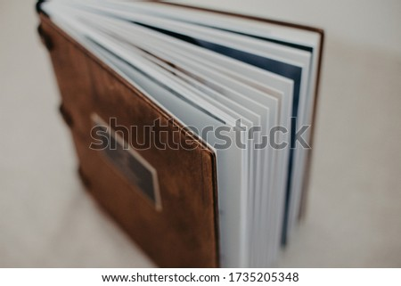 Luxury wooden photo book on linen natural background. Family memories photobook. Save your summer vacation memories. Photo album wedding photoalbum with wooden cover.