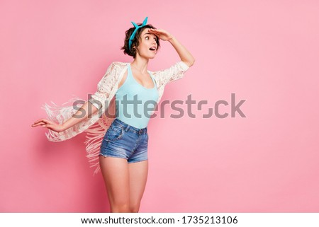 Portrait of her she nice attractive lovely charming pretty dreamy cheery girl looking far away expecting miracle air wind blowing isolated over pink pastel color background