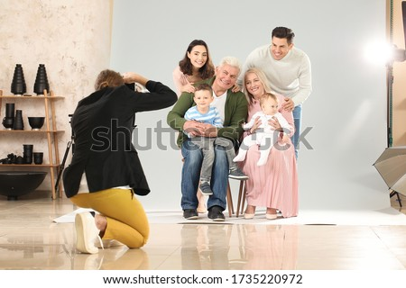 Photographer working with family in studio
