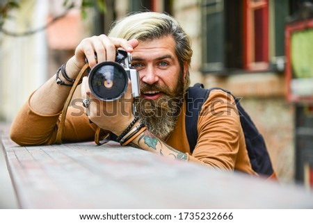 just smile. travel tips. professional photographer use vintage camera. bearded man hipster take photo. photo shooting outdoor. brutal man traveler with retro camera. photography in modern life.