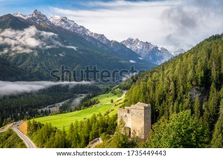 Silvretta Alps surrounding the village of Ramosch (Val Sinestra, Graubünden, Switzerland). It lies in the Lower Engadin valley along the Inn River, and is famous for its 12th-century Tschanüff Castle #1735449443
