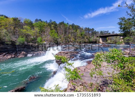 Strong flowing turquoise water after heavy rain at Little falls in Little River Canyon National Preserve Royalty-Free Stock Photo #1735551893