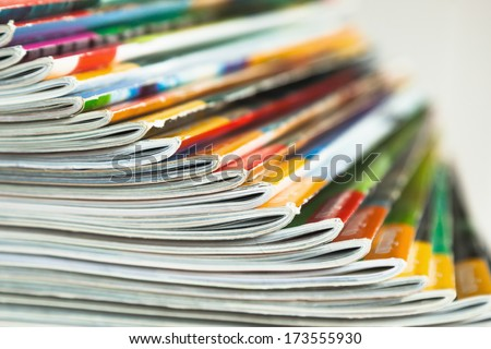 fanned out pile of magazines Royalty-Free Stock Photo #173555930
