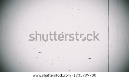 Vintage looping film strip melting background. 4K Reel Clutter, Old Tv and film grain noise. Videotape with scratches and stains. Camera roll with Distortion, Dirt and Scratches animation. Royalty-Free Stock Photo #1735799780