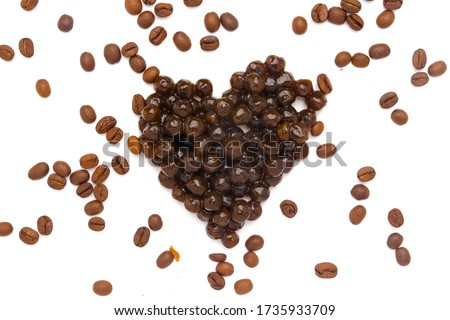A picture of tapioca ball or pearl tea in heart shape with coffee bean for boba pearl coffee milk