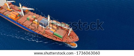 Aerial drone panoramic ultra wide photo of industrial container tanker ship cruising in open ocean deep blue sea