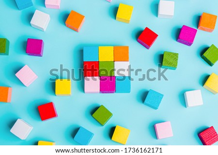 Chaotically disorganized colored cubes and ordered. The concept of business model, structure, logical solution of the organization. order and chaos. #1736162171